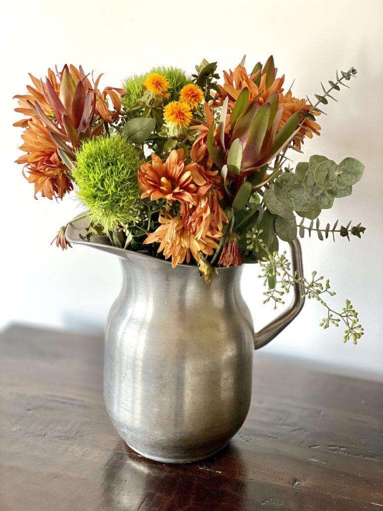 Fall flower arrangement in pitcher