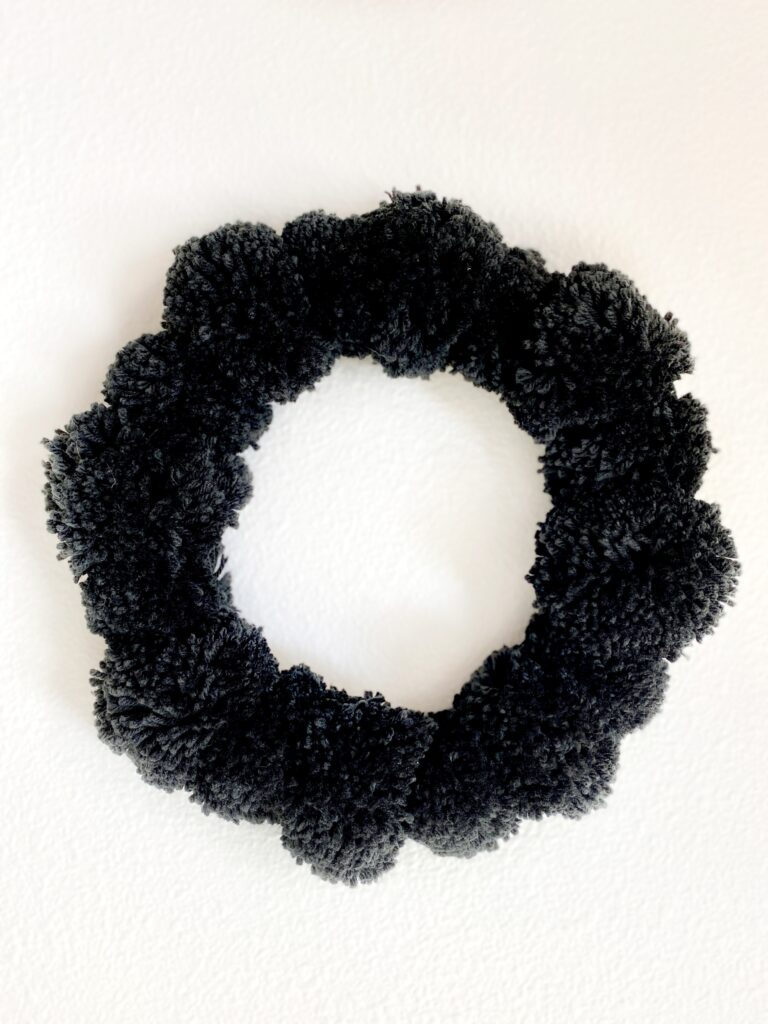 Black pom pom wreath