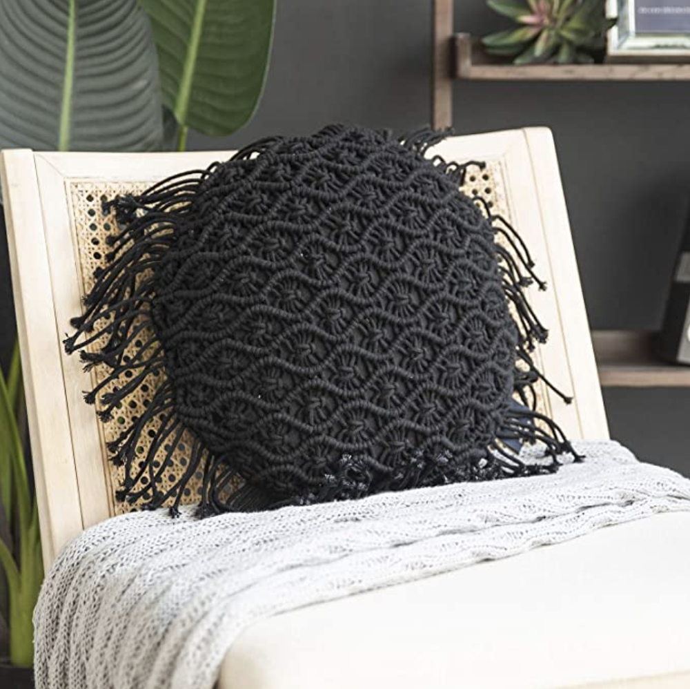 round black macrame pillow cover on chair